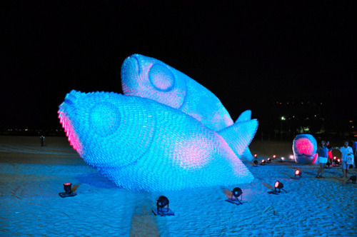 artresort:  Discarded Plastic Bottles turned to Giant Fish Sculptures Think how many large fish sculptures could be created out of one days worth of world consumption of plastic water bottles, it would be much larger than a school of fish.  In conjunction with the UN Conference of Sustainable Development (Rio+20) a number of illuminated fish sculptures were created from discarded plastic bottles in Rio De Janeiro.  (via Juxtapoz Magazine)