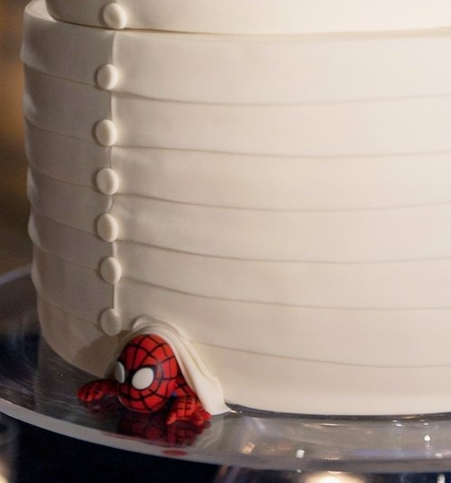 lacedinweddings:  What a great idea! Hide his favorite super hero under the cake…Spiderman is made out of fondant. Photography by Jennifer Skog Cake by Studio Cake.