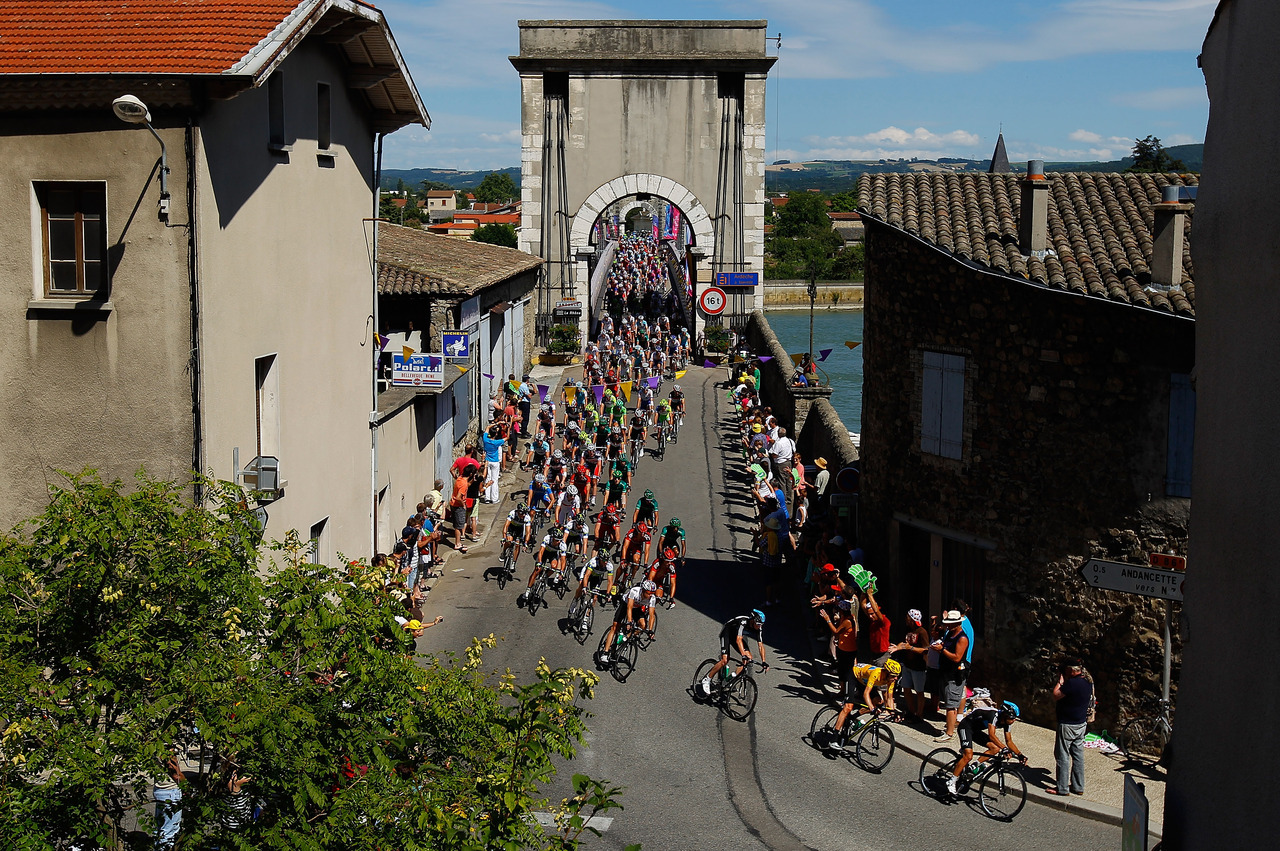 "Tour de France racers are used to dodging flags, people and the odd stray dog along the race route. But flares? Overall leader Bradley Wiggins wasn't so lucky during Friday's 12th stage from Saint-Jean-de-Maurienne to Annonay in the Ardeche region. The Briton was burnt on the arm by a spectator carrying a flare and running alongside the peloton as it raced over the Col du Granier, one of the two category-1 climbs during the stage. ""I got hit in the arm with a flare, it burnt my arm a bit,"" Wiggins said after the race. ""It was some nutter running up the hill and it shows you freak things like that can happen in the Tour. I'm fine though."""