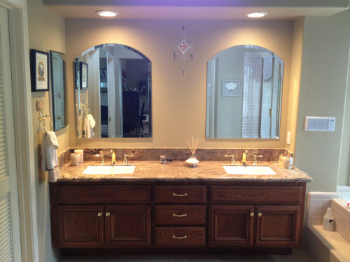Bathroom remodel included new faucets, sinks, counter, paint, soft-close hinges, cabinet refinish, medicine cabinet, custom beveled mirrors, toilet, and tub valve/trim.