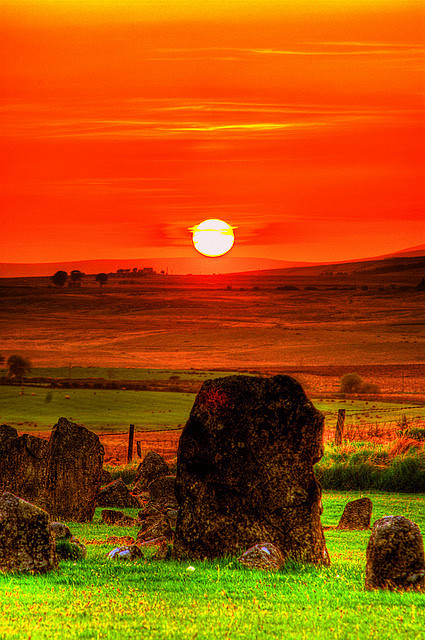 Sunset over Beaghmore Stone Circles by Irishphotographer on Flickr.Via Flickr: The area around the Sperrins Mountains in counties Fermanagh, Londonderry and Tyrone is home to a concentration of distinctive sites comprised of multiple stone circles associated with cairns and stone rows.  The rings here are of small diameter and the stones themselves are diminutive, most struggling to achieve knee height. As if to compensate for the small size, the rings are comprised of numerous, almost contiguous stones, a count of over forty being usual. The rings are nearly always misshapen, and frequently occur in paired or multiple arrangements, stone rows leading to cairns are also common features. Of the three counties mentioned above, Tyrone is the focus for these monuments, with 80% of its 61 known circles occurring in paired or multiple arrangements, but its most famous example must be the stone circle and row complex at Beaghmore. The circles and rows we see at the site today are thought to date from about 1600 BC, the early Bronze Age, but they are not the earliest evidence of usage of the site. Hearths and deposits of flint tools were discovered and have been carbon dated to 2900-2600BC, in addition, several of the stone rows run over the tumbled walls of field structures which also date from the Neolithic period.