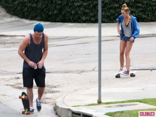 Miley Cyrus sports short shorts, skateboards with Liam Hemsworth