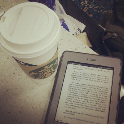 kimmybeth:  Wasting time in the airport time to go home :) #kindle #Starbucks #Orlando #airport (Taken with Instagram at Orlando International Airport (MCO))