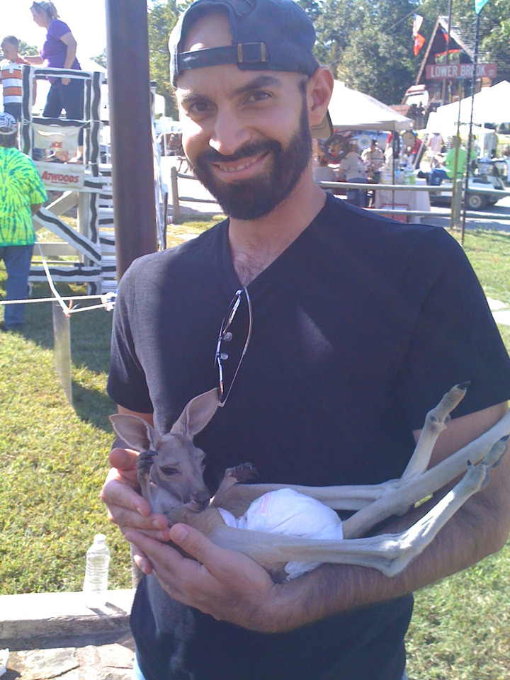 Flashback Friday: Winefest 2010, holding a baby kangaroo.