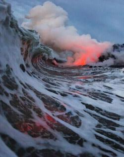 Incredible shot of waves during a volcanic eruption in Hawaii.