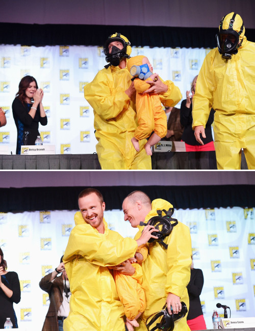 bohemea:  Breaking Bad Comic-Con panel, July 13th 2012 Aaron Paul & Bryan Cranston wore hazmat suits & carried baby dolls in matching suits.  Vince Gilligan wore a Heisenberg t-shirt.  Dean Norris wore a Xena costume.  This cast is the best!