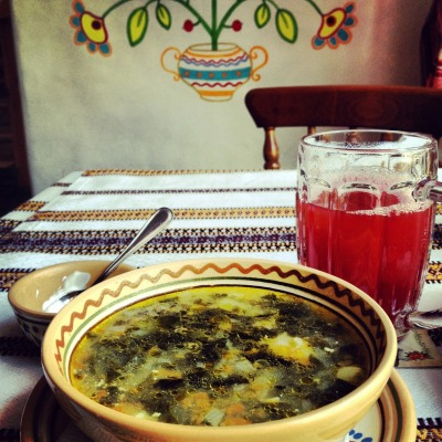 whatweeatinukraine:  green borsch with smetana and cranberry mors 52 UAH / $6.5 at Taras Bulba tavern, Kiev