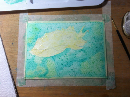 First wash of color for the background. Just got the paper really wet and blotched on blues and greens, to create some texture I splattered the whole thing with rubbing alcohol.