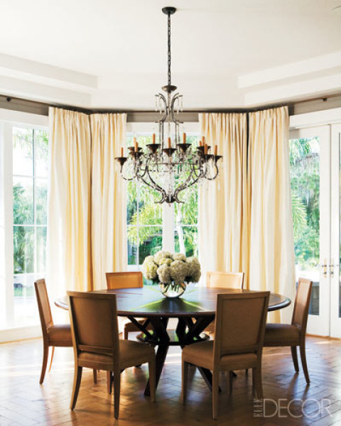 chic dining room with cream curtains