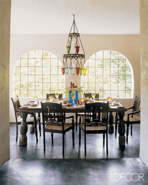 great windows and a colorful chandelier