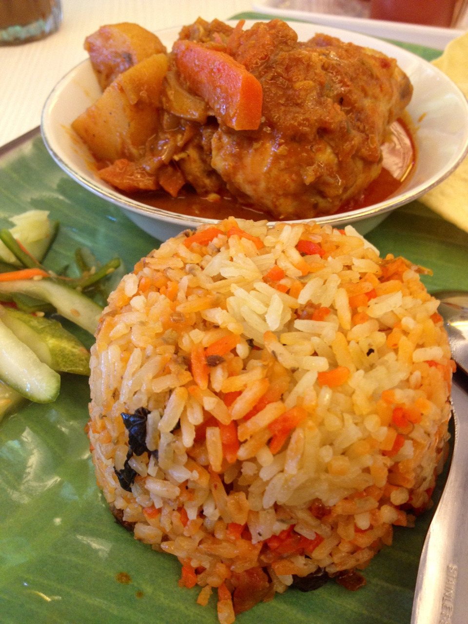"Briyani Rice with Chicken Curry from Ah Mei Cafe, Jakarta. I was so thrilled when I found out that Ah Mei opens its branch in Jakarta. I used to come here a lot -until they closed down (T_T)- when I was in Singapore, its so near my school and has great comforting food. Their dishes taste quite authentic compared to other places labelled ""kopitiam"". They even served Prata and Roti Jon! Would definitely come back here :p"