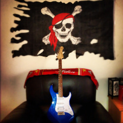 Shot of 3 of my fav things ..my electric blue guitar..pirates flag..and AC Milan :D