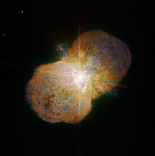 leviathan8:  Eta Carinae   This image of the luminous blue variable Eta Carinae was taken with the NACO near-infrared adaptive optics instrument on ESO's Very Large Telescope, yielding an incredible amount of detail. The images clearly shows a bipolar structure as well as the jets coming out from the central star. Because of its mass and the stage of life, it is expected to explode in a supernova or even hypernova in the astronomically near future.  Credit: ESO