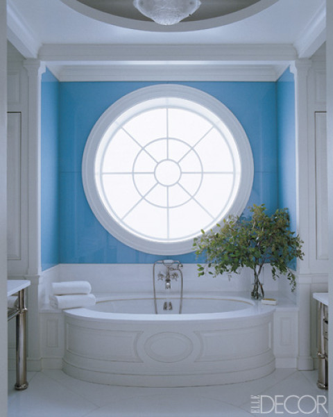 turquoise bathroom with round window