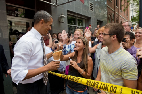 President Barack Obama greets people gathered outside of Deb's Ice Cream & Deli in Cedar Rapids, Iowa, July 10, 2012. (Official White House Photo by Pete Souza)