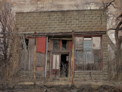 An abandoned, decaying store in Piedmont, Kansas. Cracked and gutted by jimsawthat on Flickr.
