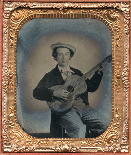 ca. 1855, [ambrotype portrait of a young man playing his guitar] via Charles Schwartz Photography