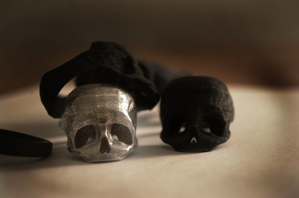 The Skull Ring by Bits to Atoms is 3D printed in stainless steel with a tessellated and slightly pitted texture. A masculine piece that works just as well with denim jeans and a t-shirt as it does with a 3 piece suit (or formal dress). Please contact for bespoke sizing. 3D Printed by Shapeways