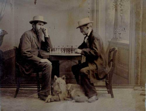 ca. 1880-1910, [tintype portrait of two western gentlemen playing chess, with a dog, more likely a taxidermied coyote or wolf, at their feet], Voss via Jeffrey Kraus, Antique Photographs