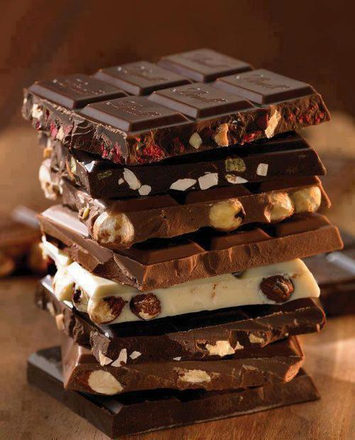 yummmaystuff:  yummaystuff  assortment of stacked chocolate bars.