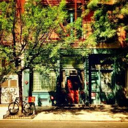"nythroughthelens:  Summer on the Lower East Side. New York City.  I fall in love with this city every day.   It's the little things that build up to create an imprint: an imprint that etches itself permanently to my heart.   Certain streets transport me to different eras and even different places in the world. I turn a corner and I am suddenly transported to Paris or Prague or a multitude of places that I have never had the pleasure of exploring (yet).   And it's these streets that make me well up with enough love to last a lifetime.  —-  This photo was taken with my phone. I am @newyorklens on Instagram (view my feed here).  Check out my other Instagram posts made to this blog here. You can check out all of my Instagram photos on Flickr here. Additionally, you can view my phone photography for sale here.  —-  View this photo larger and on black on my Google Plus page   —-  Buy ""Summer Sun - New York City "" Prints here, My mobile photography for sale here, My regular photography for sale here, email me, or ask for help."