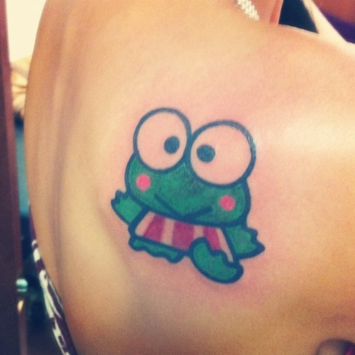 I got a Keroppi Tattoo, because I have been a Hello Kitty/Sanrio addict for years. He is my personal favorite from the group. I got him done at Cowboy's Tattoo Emporium in Mckinney Tx on his birthday!!!! (keroppi was invented july 9th!)