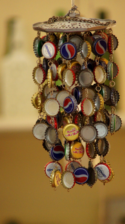 unconsumption:  A classic DIY wind chime idea: Repurpose bottle caps. Lovely garden art. (Photo by Pianista.9)
