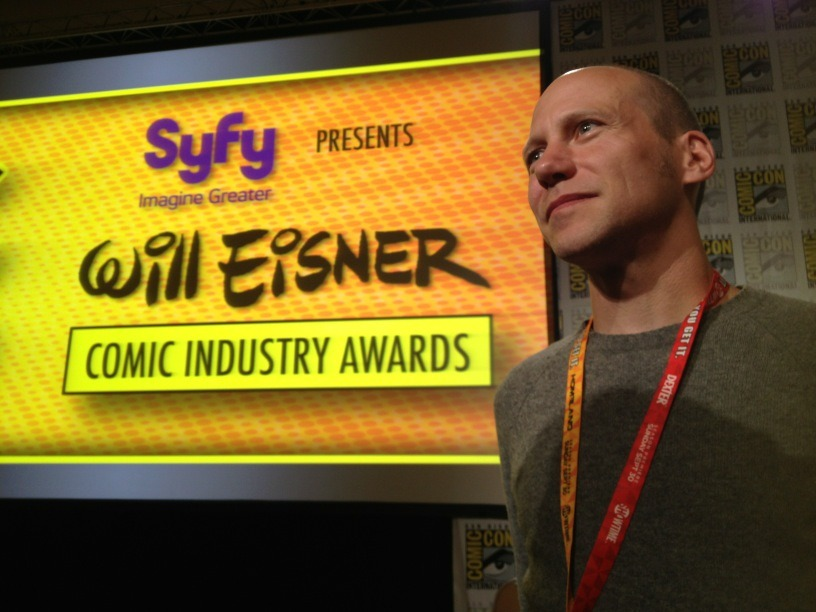 "Congratulations, James Our good pal and SuperF*ckers creator James Kochalka will be returning to Vermont from San Diego Comic-Con one Eisner Award heavier after last night's ceremony honoring the best in American comic books. His book, Dragon Puncher 2: Dragon Puncher Island (""visually engaging and exceedingly goofy,"" says the City Book Review), is this year's winner in the Best Publication for Early Readers category. You're our hero, James. Picture courtesy of James's publisher, Top Shelf Productions."