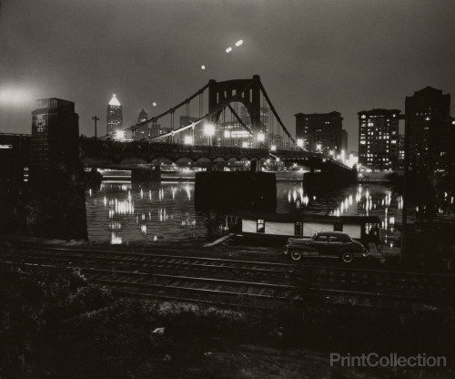 thepittsburghhistoryjournal:  Pittsburgh at night, 1955. W. Eugene Smith.   Thirty-two. Also, I'm dying to stand beside a train and feel the wind hit me right in the fucking face.