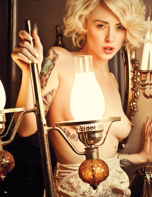 Alysha Nett for Retro Lovely Magazine's Taboo The beautiful Alysha Nett poses for the 4th edition of Retro Lovely Magazine. This nude portrait was shot by Redrum Collaboration. Alysha looks stunning in this classic setting and her blonde hair. Although Alysha's tattoo's are a bit distracting in this photograph, it would be a pity to photoshop them. Hair was done by Ryan Heneghan and make-up by Bambi Face.
