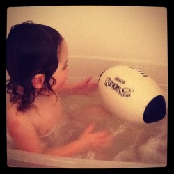 Even takes it in the bath #rugbyball (Taken with Instagram)