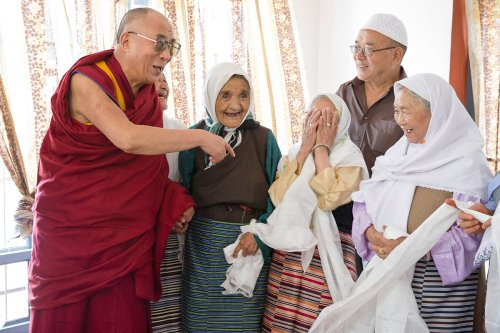 therapyinminneapolis:  His Holiness the Dalai Lama enjoying a moment of laughter with some of the elders of the Tibetan Muslim community who escaped from Tibet in 1959/1960 during his visit to Srinagar, J&K state, India on July 14, 2012.  Photo/Tenzin Choejor/OHHDL