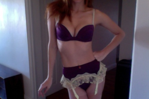 Fifi Chachnil bra, thong and suspender belt. The beautiful dark purple silk and lemon yellow lace trim of this set is what sold it to me. Stunning. Adorable. Girlish and frou-frou, but still a little dark and sexy. Usual Fifi-cut bra:i.e., amazing low-cut cleavage and support. Beautiful soft silk and lace, like butter. But I think I've worn this too much as it's faded within an inch of it's life in spite of careful hand washing and the trim is not in the best condition now. All three pieces are insanely comfortable. This was perfect when I bought it a 10/10 in fact, now it's a around an 8.5/10. Love, love, love this though, a total dream set.