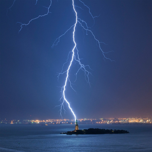 Lightning strike the Statue of Liberty..