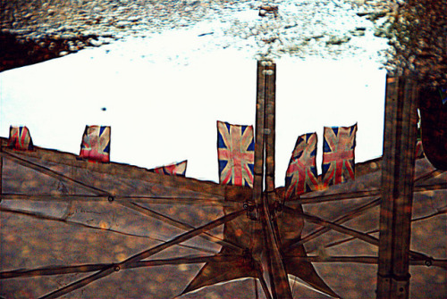 British summer 2012 on Flickr.British summer 2012.  Faded jubilee flags reflected in a puddle..