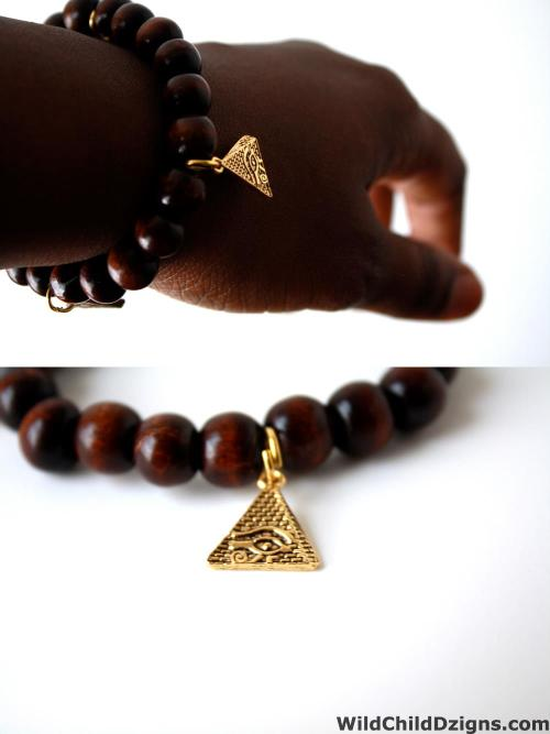 #unisex pryramid charm bracelet with The eye of Horus etched onto the surface . Available at wildchilddzigns.com