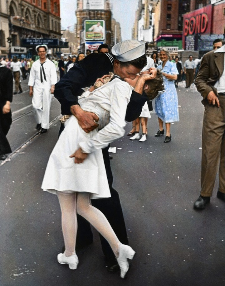 "alyssaemilie:  Famous Times Square Kiss in Color Black and white version of this photograph by Alfred Eisenstaedt. It was taken on V-J Day in Times Square and was published in Life magazine in 1945.Reddit user mygrapefruit colorized the photo using Photoshop CS 5 on a Wacom tablet. ""I found some vintage postcards of Times Square to figure out the color of the buildings and some signs,"" she said. ""The rest of the colors I guessed by using common sense.""  This woman is clearly being assaulted."