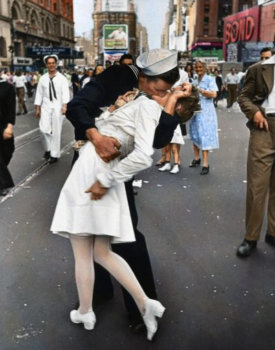 Famous Times Square Kiss in Color Black and white version of this photograph by Alfred Eisenstaedt. It was taken on V-J Day in Times Square and was published in Life magazine in 1945.