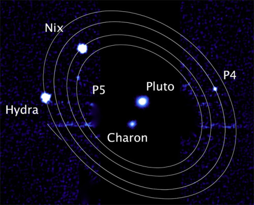 "discoverynews:  Not a Dwarf: Is Pluto a Binary Planet?  Last week the infamous ""un-planet"" Pluto grabbed science headlines with the report of yet anther moon whirling around it. The Hubble Space Telescope discovery brings the tally of icy moons orbiting Pluto to five. Or is it really four?  Ray Villard with more on Pluto"