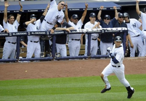Derek Jeter's teammates celebrate after he hits a HR for his 3000th hit. What a moment.