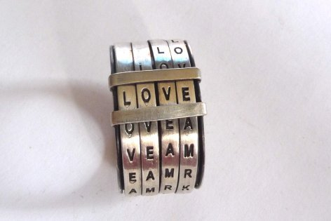 wickedclothes:  Love Ring The perfect gift to serve as a reminder of your eternal commitment to each other, as best friends, or lovers, or even both. For her and him! This unique band can spell words like love, kiss, ever, more, fun, amor, beso, etc. Sold on Supermarket.