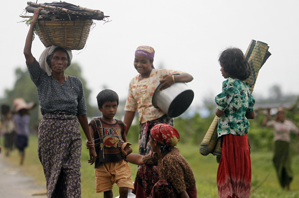 "Rohingya Muslims carry their belongings as they move after recent violence in Sittwe. (PHOTO: Reuters) UNHCR Rejects Rohingya Resettlement Suggestion The United Nations High Commissioner for Refugees has rejected an offer by Burmese President Thein Sein that the UN agency take responsibility for resettling Burma's Rohingya community in third countries. On Wednesday, Burma's presidential office released a statement, citing that it will hand over responsibility for the Rohingya minority to the UN's refugee agency in Arakan State, adding that it is also ""willing to send the Rohingyas to any third country that will accept them."" UNHCR chief Antonio Guterres, who met Thein Sein in Naypyidaw on Wednesday, told reporters at a press conference in Rangoon the following day that the UN's resettlement program is totally unrelated to the situation in Arakan State. Guterres said, ""The resettlement programs organized by UNHCR are for refugees who are fleeing a country to another, in very specific circumstances. Obviously, it's not related to this situation."" The Portuguese diplomat said that the UNHCR does not discriminate and will continue to provide humanitarian assistance to both communities—Rohingya Muslims and Arakanese Buddhists—who have been affected by the recent sectarian violence in Arakan State. The UN refugee agency estimates that 91,000 people have been affected by the violence and says 82 temporary camps have been set up to accommodate the displaced. Speaking to The Irrawaddy on Thursday, Kitty McKinsey, the regional spokesperson for the UNHCR in Asia, said, ""Resettlement under the UHNCR program is only for recognized refugees. And people cannot be refugees in their own country. So it is not logical to talk about resettlement for people who are in their own country,"" said McKinsey. She also said that the UNHCR has no policy to register people as refugees if they are domestically displaced in their own country. Apart from Rohingya issue, Thein Sein and Guterres also discussed plans for bilateral cooperation in handling the affairs of Burmese refugees at the Thai-Burmese border, as well as Kachin war refugees in northern Burma. Guterres is planned to leave for Bangkok on Friday to meet with Thai Premier Yingluck Shinawatra to discuss the return of more than 150,000 Burmese refugees who are currently sheltered at nine camps along the Thai-Burmese border.  Except it is the responsibility of the Burmese government to ensure that the Rohingya have a place to live. The Rohingya are Burmese, not 'illegal immigrants' that need to be driven out, and they deserve autonomy."