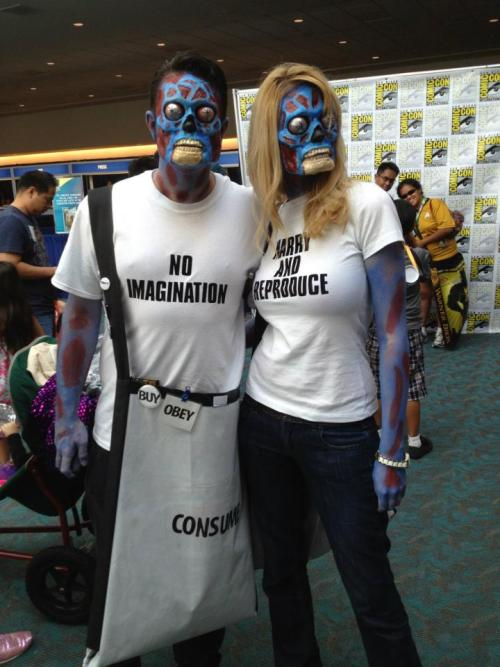 fonik:  superpunch2:  They Live cosplay.  I would have loved to have seen this.  —- But is the skin color canon?