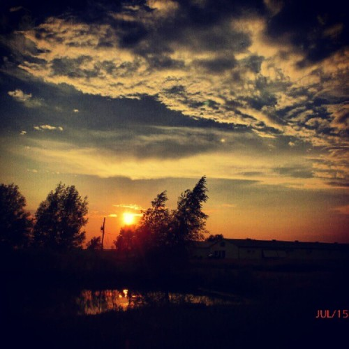 #sky #clouds #sun #trees #barn #water #reflection #sunset  (Taken with Instagram)