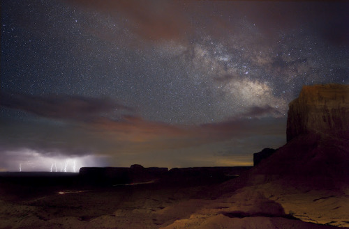 ikenbot:  Valley of the Lightning Galaxy The Milky Way rising over Monument Valley as lightning flashes from storms rolling through the desert.