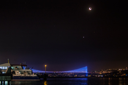 Occultation of Jupiter over Bosphorus  Meeting of the planets over the bridge which connects two continents. The Bosphorus Bridge is one of the symbolic structures of Istanbul. At night, the bridge's colors changes every few minutes.