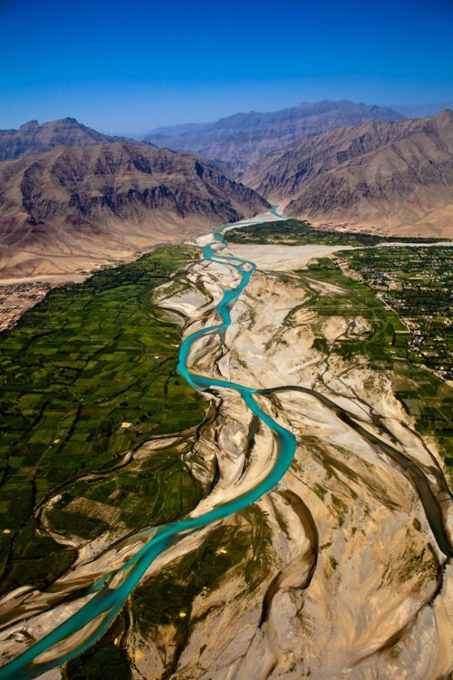 afghanistaninphotos:  River running through the Afghan mountains. Photo by Henk Boneschans.