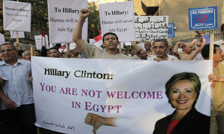 Egyptians protest visit of Hillary Clinton July 16, 2012 A number of liberal and Christian politicians and public figures have condemned US Secretary of State Hillary Clinton's visit to Egypt, accusing the United States of harbouring bias towards Egypt's Islamist parties, especially the Muslim Brotherhood.  This has coincided with several popular demonstrations against Clinton's visit outside the US embassy in Cairo, the presidential palace and the Four Seasons hotel in which Clinton is staying.   Liberal parties and movements, including the Free Egyptians party and the Front for Peaceful Change, have participated in the protests against Clinton's visit, which have recently shifted from the US embassy to the presidential palace.  They were joined by other political forces opposed to Egypt's revolution, including supporters of Mubarak-era vice president Omar Suleiman.  The Front for Peaceful Change, a pro-revolution youth group, issued a statement on Saturday calling on the Egyptian public to participate in the protests to register its rejection of perceived US interfere in Egypt's affairs and its alleged deal-making with the Muslim Brotherhood. Accusations of a secret agreement hammered out between the US and the Brotherhood is a common refrain among the opponents of Clinton's visit.   Source