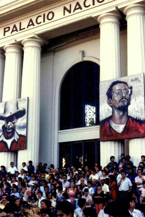 catwriter:  Paintings of Augusto Sandino (left), who fought the US Marines, became a hero to oppressed peoples and revolutionaries and was assassinated in Nicaragua in 1934; and Carlos Fonseca (right), founder of the Sandinista National Liberation Front (FSLN) in the early 1960s who was killed before the Sandinistas overthrew US-backed dictator Anastasio Somoza in 1979, grace the National Palace in Managua, where Sandinista supporters rallied on an afternoon in 1985.