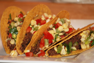Black bean tacos with a corn salsa, great for summer! Get the recipe here